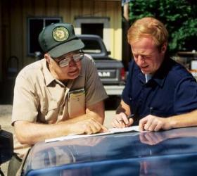 Forester consulting with landowner